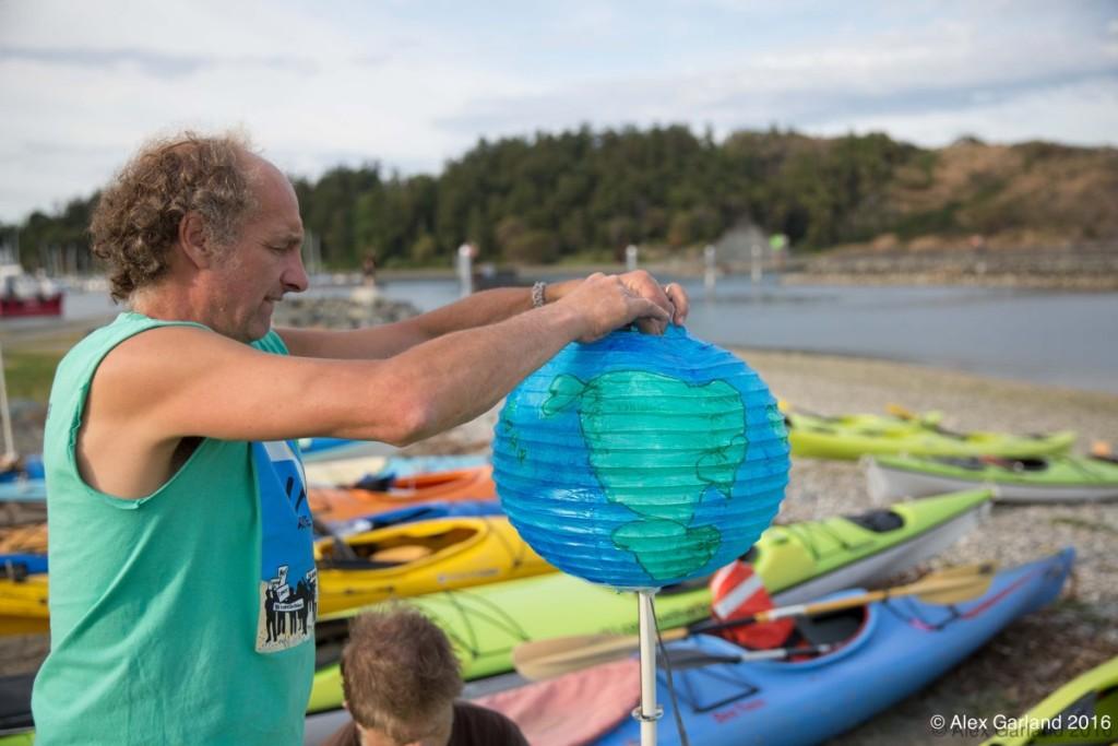 climate action globe amd kayaks